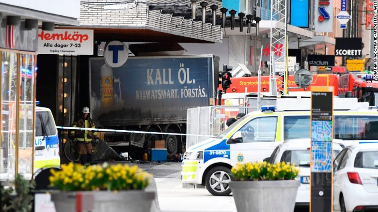 "Emergency services work at the scene in Stockholm, where a truck was driven into pedestrians on Friday. ""Everything indicates this is a terror attack,"" Swedish Prime Minister Stefan Lofven told reporters."