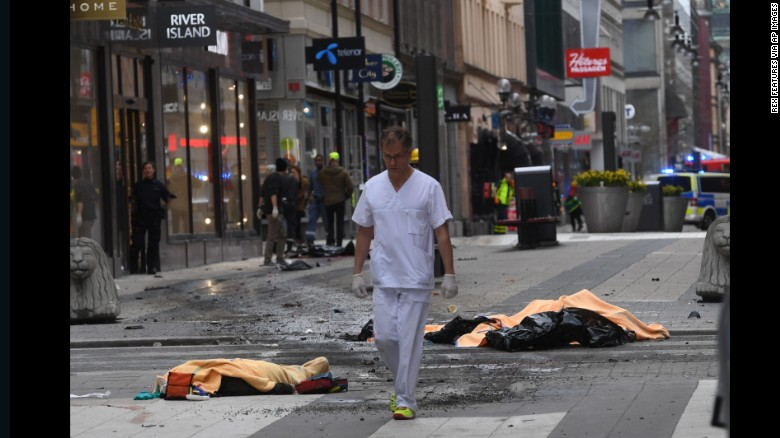 A medical responder moves through the scene of the attack. Stockholm police made an arrest in connection with the incident, police spokesman Lars Bystrom told CNN.