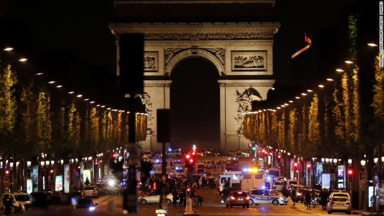 Police officers block access to the Champs-Elysees.