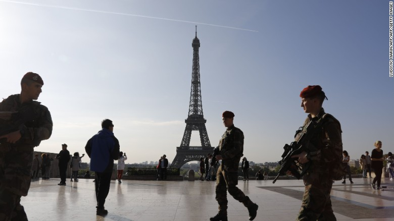 Soldiers guard the Eiffel Tower area in Paris on Sunday as security is stepped up for the presidential vote.