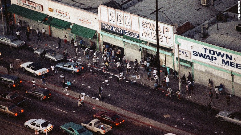 Looters go in and out of a swap meet in South Central Los Angeles on Wednesday, April 29, 1992.