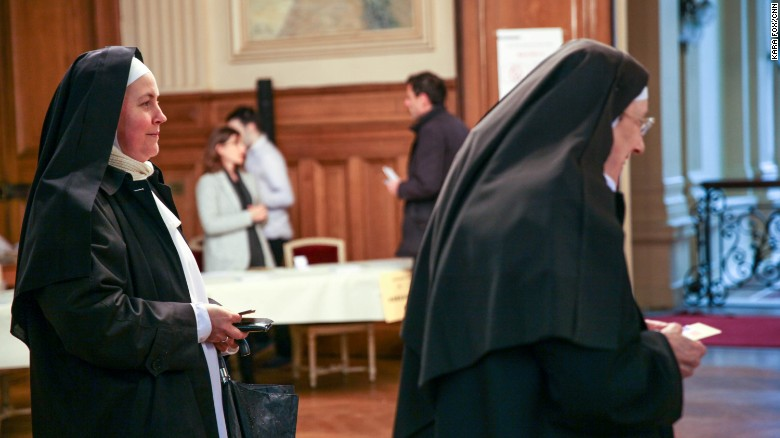 Nuns from the Benedictine Sisters of the Sacred Heart in Montmartre cast their votes at a polling station in the 18th district of Paris.