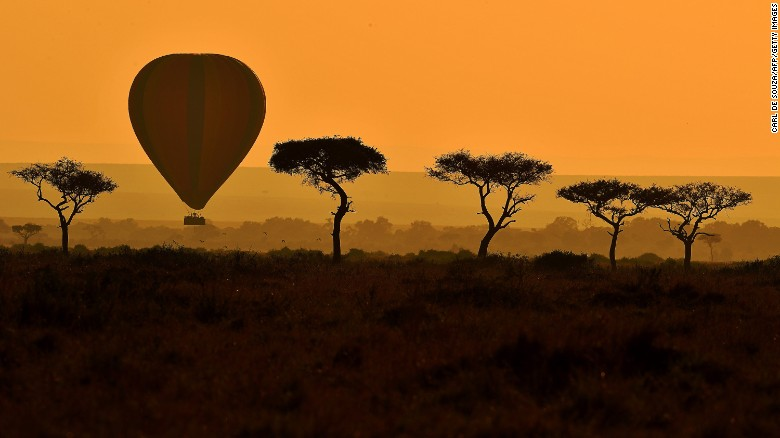 A hot air balloon carries tourists during the annual wildebeest migration in the Maasai Mara game reserve.