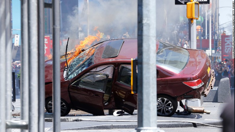 A wrecked vehicle is on fire after hitting pedestrians in New York's Times Square on Thursday, May 18. The incident is being investigated as an accident, a New York police official said. The driver is in custody.