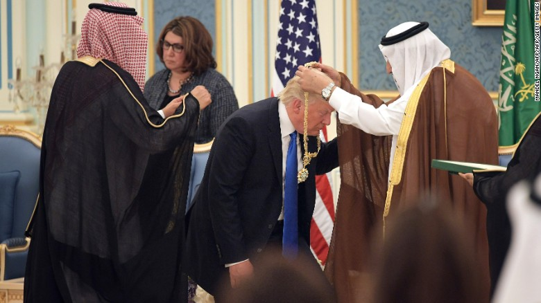 Trump receives the Order of Abdulaziz al-Saud medal from King Salman on Saturday at the Saudi Royal Court in Riyadh.