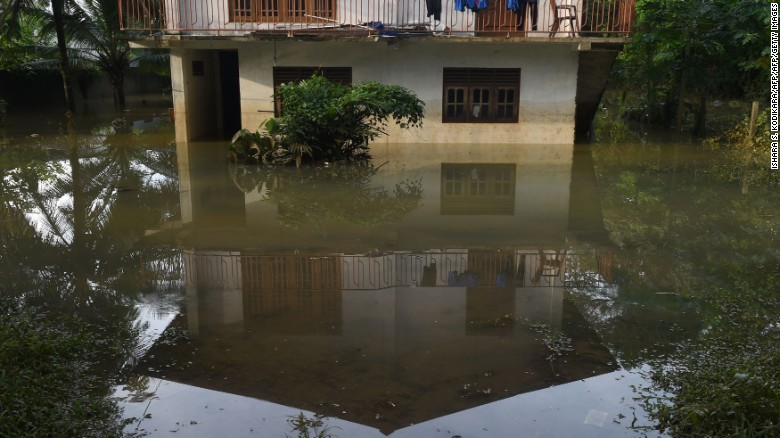 A Sri Lankan home is surrounded by floodwaters in the suburb of Kaduwela in the capital, Colombo.