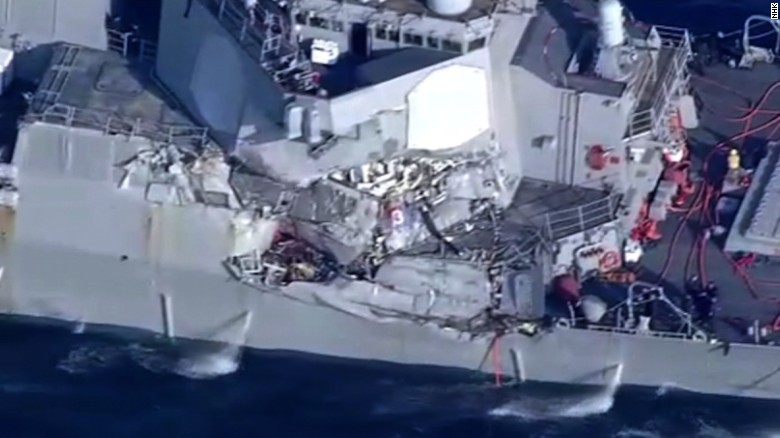 A photo from shipping company NYK shows damage from the collision.