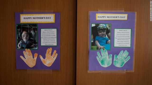 Mother's Day cards given to Nicole McDonald on behalf of her sons hang on a cabinet at Blythedale Children's Hospital.