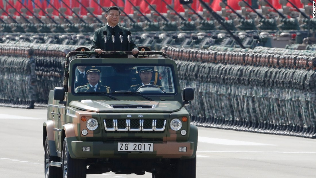 Image result for Xi Jinping addresses Hong Kong froma military vehicle, photos