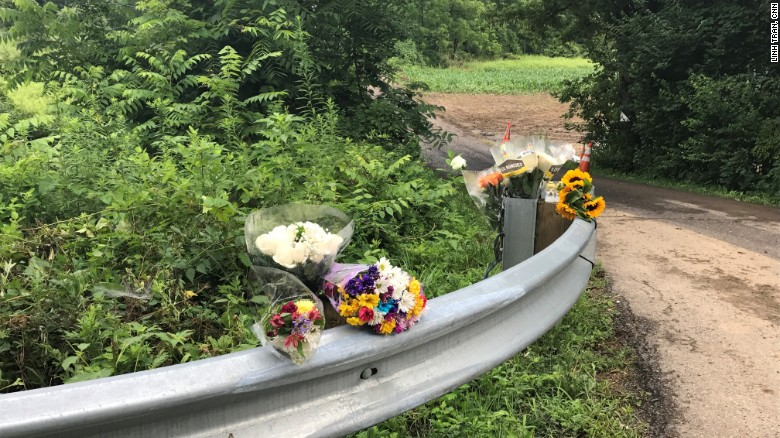 Solebury Township residents leave flowers outside farmland where four young men were killed.
