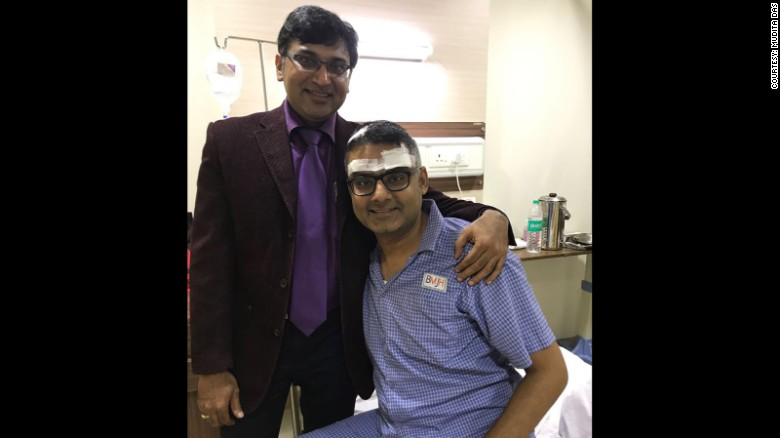 Neurosurgeon Dr. Sharan Srinivasan visits with Abhishek Prasad after the guitar player's brain surgery.
