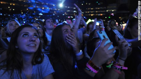 """Fans react to Taylor Swift as she performs on her """"The 1989 World Tour"""" at Raymond James Stadium on October 31, 2015 in Tampa, Florida."""