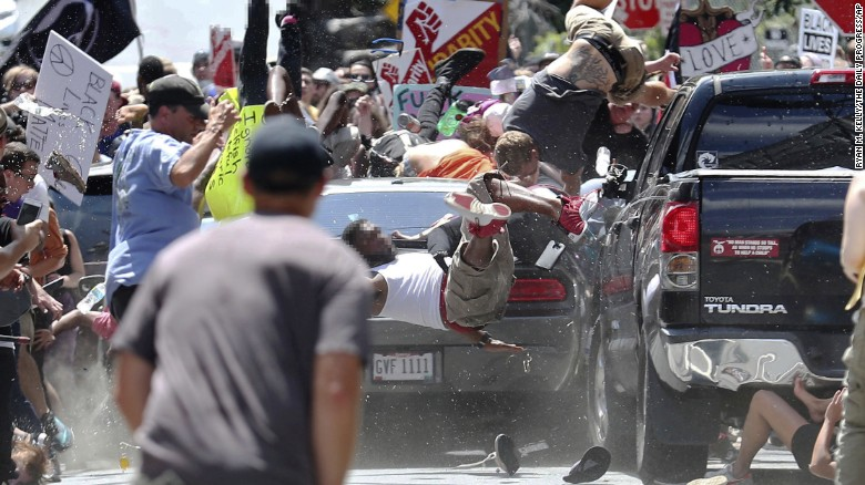People fly into the air as a vehicle drives into a group of protesters demonstrating against a white nationalist rally Saturday in Charlottesville, Virginia.