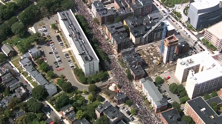 Throngs march ahead of a self-described free speech rally Saturday in downtown Boston.