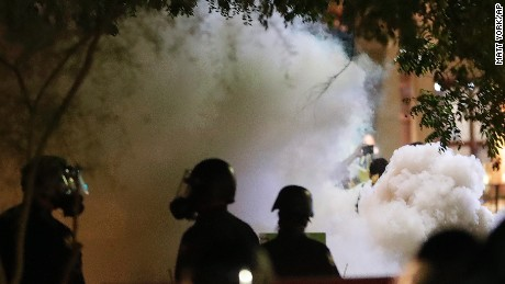 Cops throw gas canisters, protesters throw them back