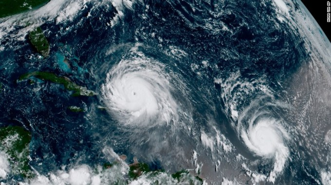 In this satellite image taken Thursday, the eye of Hurricane Irma, left, is just north of the island of Hispaniola, with Hurricane Jose, right, in the Atlantic Ocean.