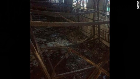 Melted bunk beds are seen on the second floor of the Kuala Lumpur religious school that caught fire.