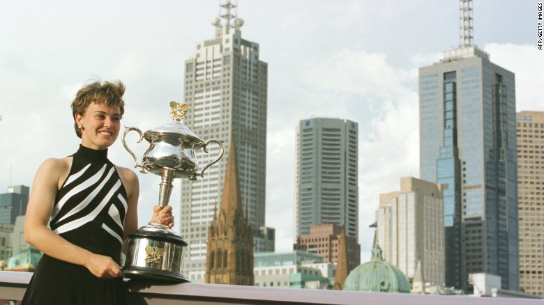Martina Hingis, 16, poses with the 1997 Australian Open trophy.