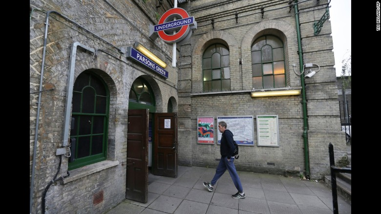 A man walks into Parsons Green subway station after it was reopened following Friday's terror attack.