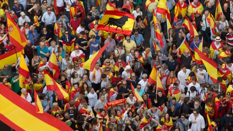 People wave Spanish national flags as thousands demonstrate Saturday in Madrid in favor of Spanish unity.