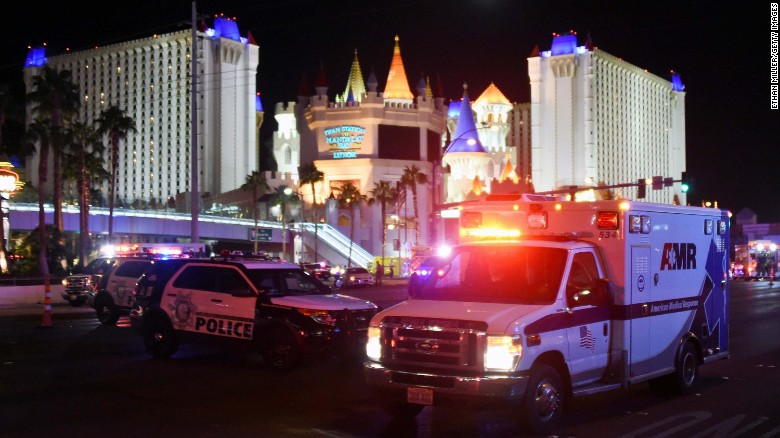 An ambulance leaves the intersection of Las Vegas Boulevard and Tropicana Avenue.