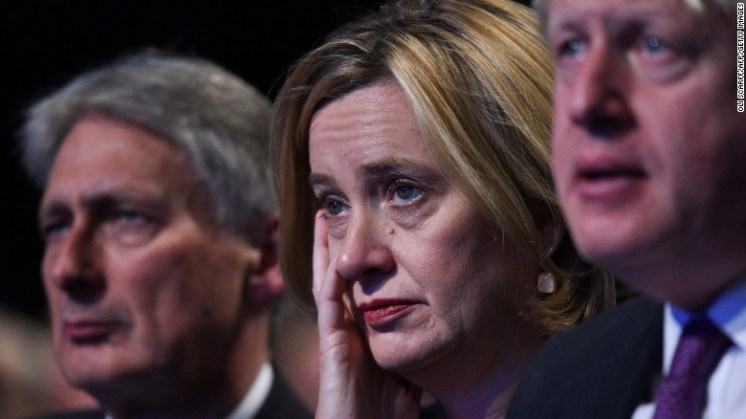 Britain's Home Secretary Amber Rudd (C) listens to the speech by Prime Minister Theresa May.