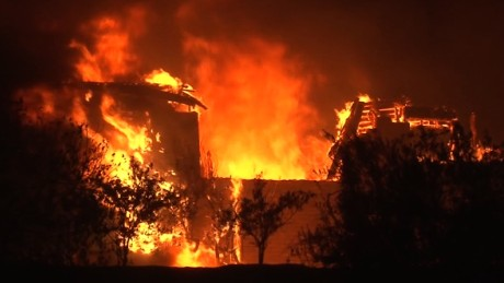 Fast-moving wildfires devour buildings, spur evacuations in Northern California