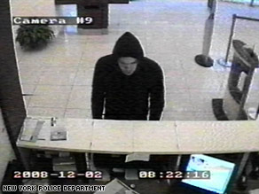 A surveillance camera captures a bank robbery suspect in New York on December 2.