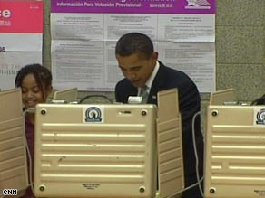 Sen. Barack Obama votes at Shoesmith Elementary School in Chicago, Illinois, on Tuesday.
