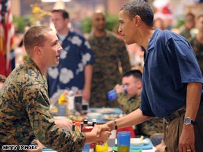 President-elect Obama shakes hands with troops having Christmas dinner at a military base in Hawaii.