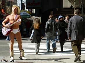 The Naked Cowboy is part of the scenery at New York's Times Square.