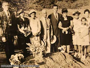 Relatives of the Malcoms and Dorseys stand at their loved ones' fresh graves in this 1946 photo.