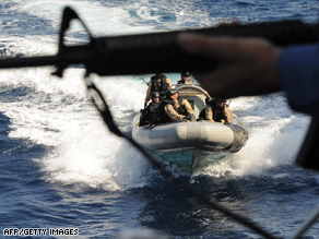 Canadian Navy sailors escort an aid ship in waters off Somalia where pirates operate.