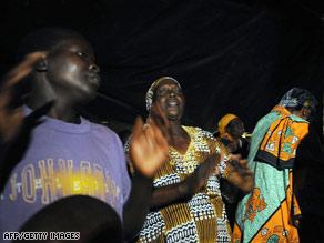 Residents of Kogelo, Kenya, celebrate news of Barack Obama's victory early Wednesday morning.