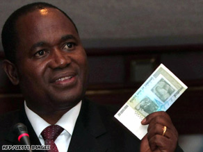 Zimbabwe central bank governor Gideon Gono shows a new $50 million note Thursday.