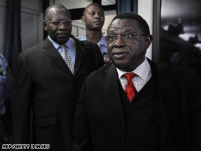 Theoneste Bagosora, right, and his co-defendant Anatole Nsengiyumva, left, arrive in court.