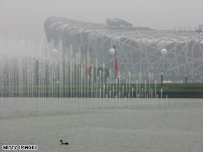 The National Stadium, known as the Bird's Nest, is shrouded in smog on opening day of the 2008 Olympics.