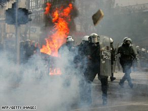 Athens riot police come under attack near the capital's main police station Sunday.