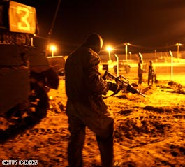 https://i0.wp.com/i2.cdn.turner.com/cnn/2008/WORLD/meast/12/27/gaza.israel.strikes/t1home.idf.prepares.gi.jpg