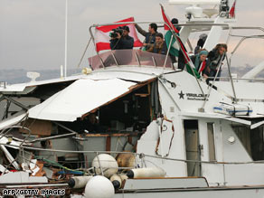 The Dignity arrives in Tyre, Lebanon, after it was reportedly rammed by an Israeli military vessel Tuesday.