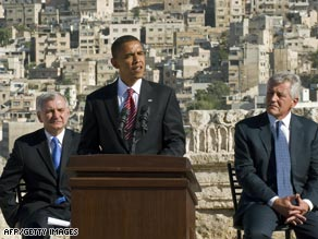 Jack Reed, left, and Chuck Hagel, right, joined Barack Obama in the Middle East.
