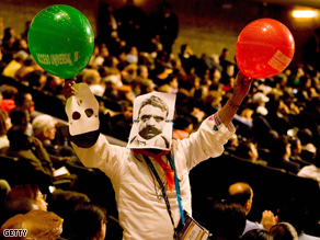 A protester stands at the opening ceremony of the XVII International AIDS conference in Mexico City