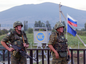 Russian peacekeepers guard their outpost at South Ossetian border in an unknown location in Georgia, Thursday.