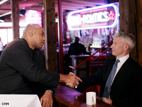 TNT Analyst Charles Barkley and Anderson Cooper shake hands at the CNN Grill in Denver, Co.