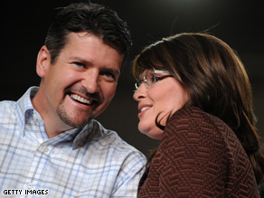 Sarah Palin campaigns with her husband by her side.