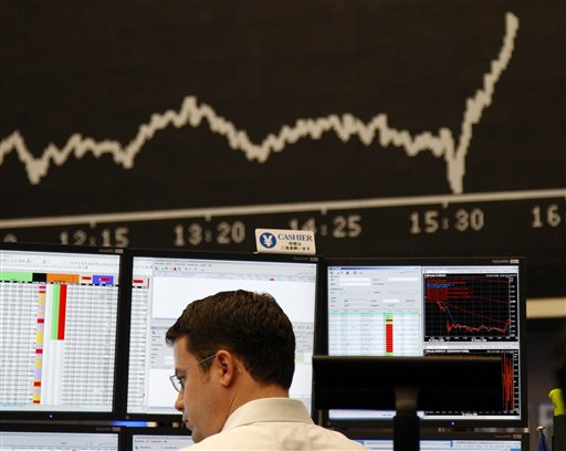 A broker is seen at the stock exchange in Frankfurt, central Germany, on Friday. Europe's stock markets plunged Friday after Wall Street opened a breathtaking 7 percent lower, below the 8,000 level, but they soon recouped some of those losses when the Dow Jones index made a partial comeback.