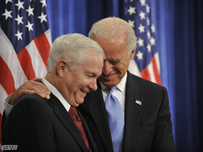 Vice-President elect Joseph Biden smiles with Secretary of Defense Robert Gates at a press conference on Monday.