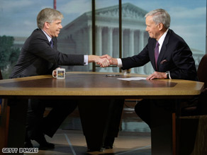 NBC's David Gregory, left, shakes hands with Tom Brokaw on the set 'Meet the Press' Sunday.