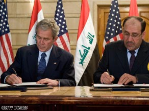 Pres. Bush signed an agreement with the Iraqi government in Baghdad Sunday.