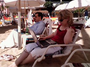 Ed Henry and producer Becky Brittain working hard on Waikiki Beach.